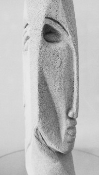 Janus mask sculpture